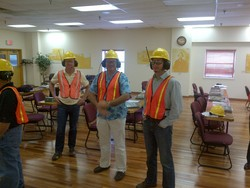 Darryl Cobb, Martin Cizler, and Trevor Draper in full protective gear at the Buckhannon Plant.